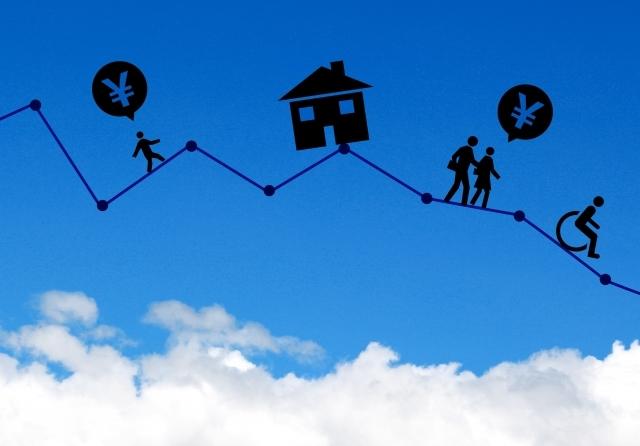 空に家とお金のシルエット