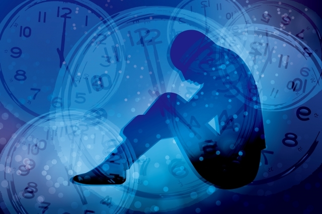 ブログ記事トップ画像_悩める人と時計